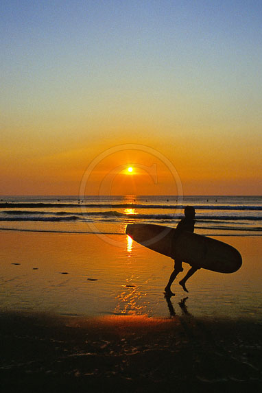 20c3867e2b 0013 Cornwall Watergate Bay Beach Sunset Surfer Running - Michael ...